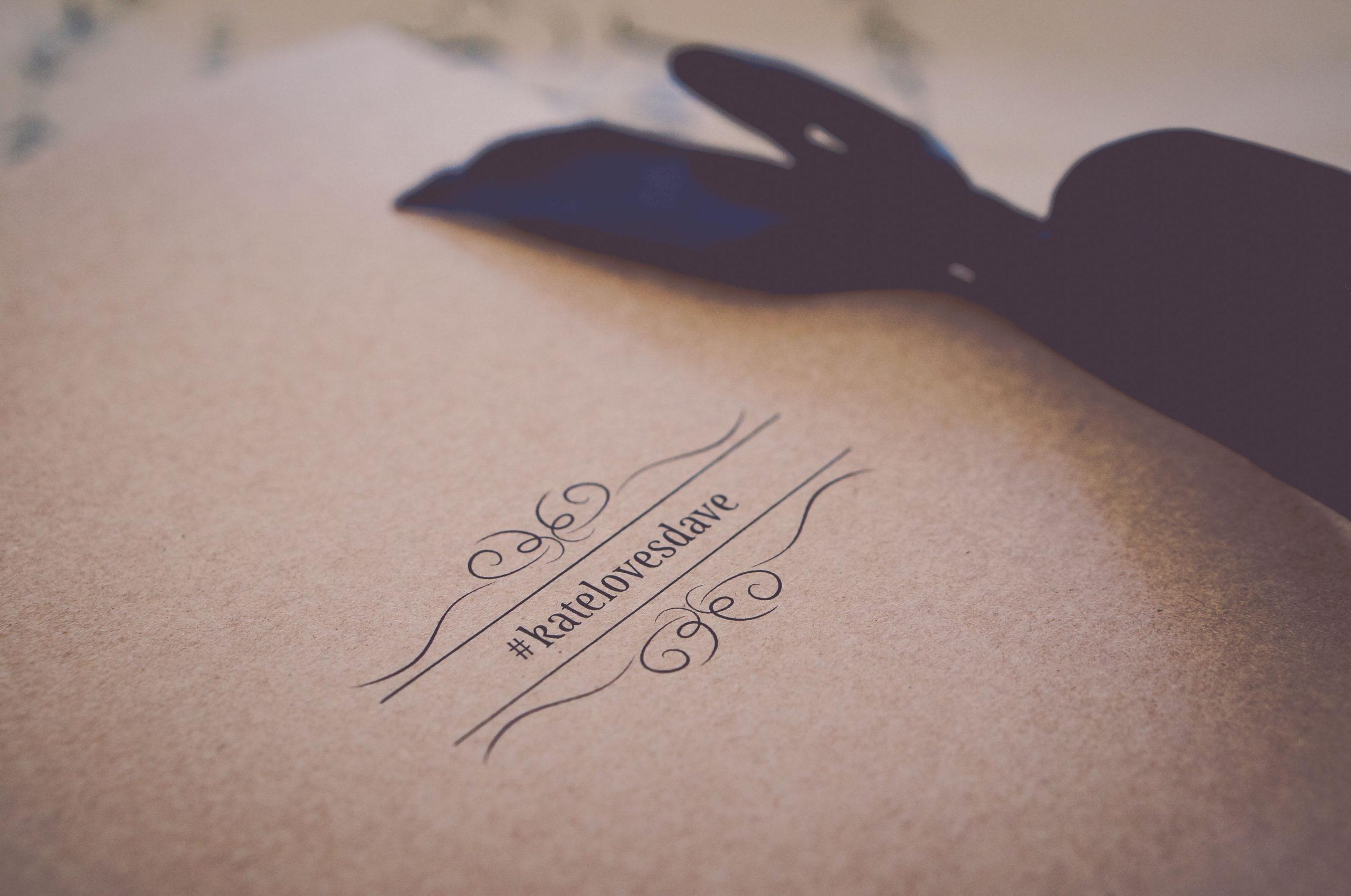 Wedding hashtag on kraft stationery