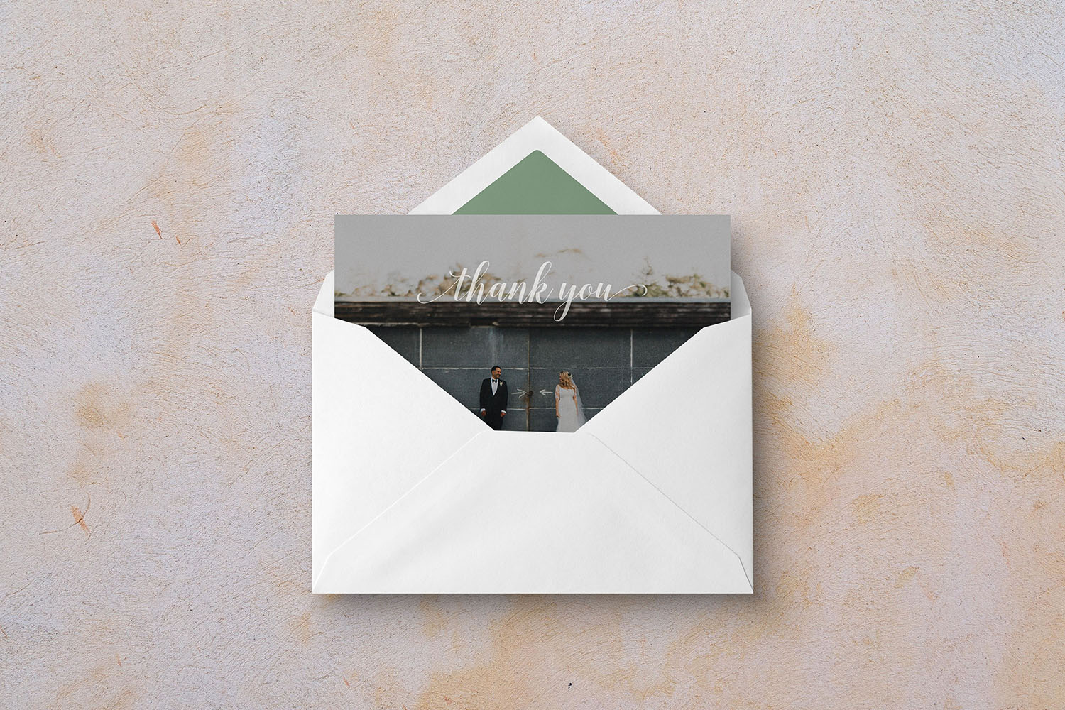 Wedding thank you card in envelope with photograph, calligraphy font