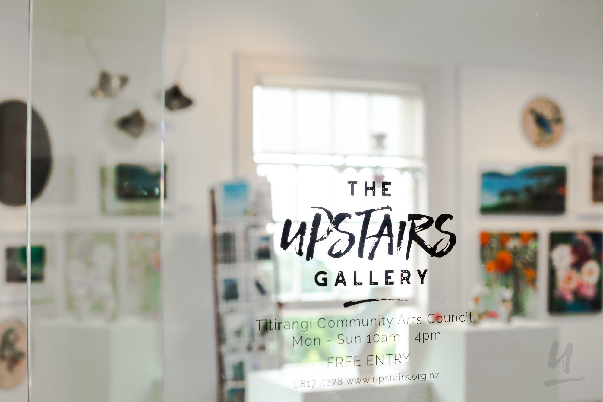 upstairs gallery window with signage